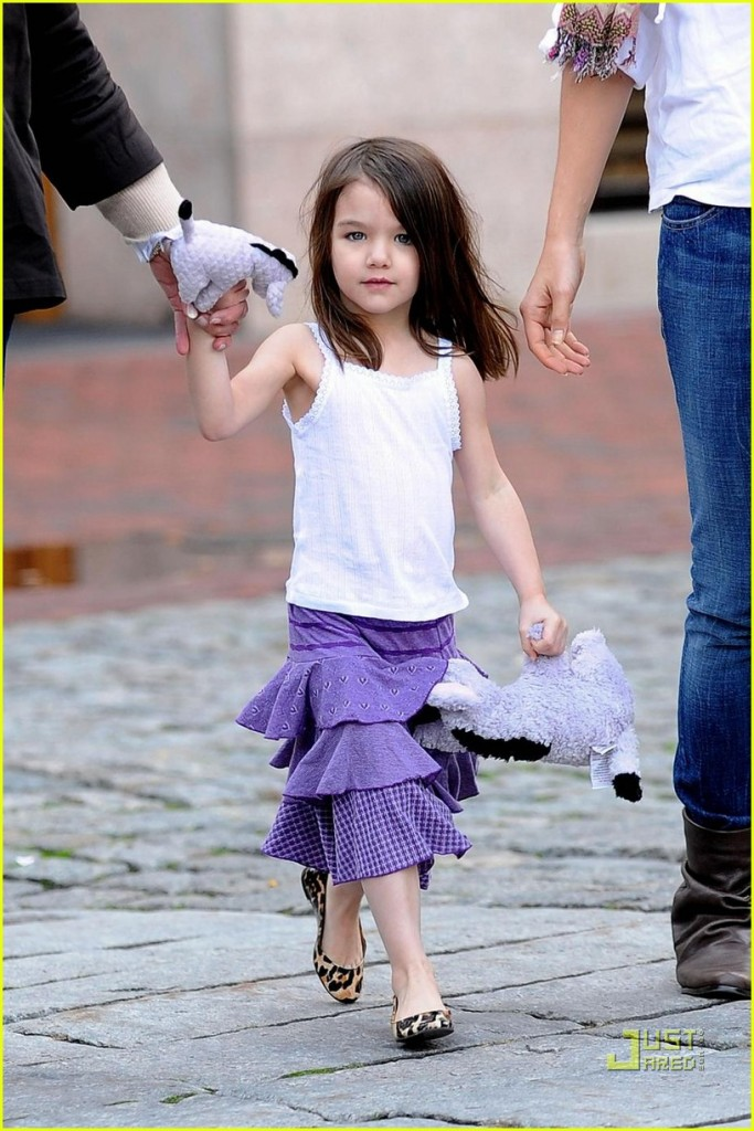 **RESTRICTIONS APPLY** Suri Cruise walks with Mom Katie Holmes and her Grandmother Kathleen while out and about in Quincy Market