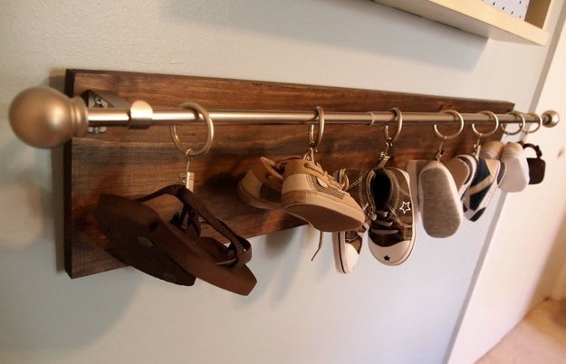 Hang baby shoes on a curtain rod.