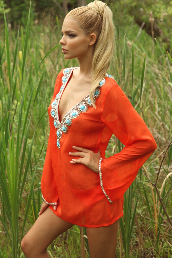 Designer Swimsuit Coverups Look fabulous at the beach or pool with trendy resortwear and swimsuit coverups from SWIMSTYLE. We have dozens of beautiful looks to choose from, whether you want a dress that will look great at the beach party, or you're more of a hoodie kind of gal.