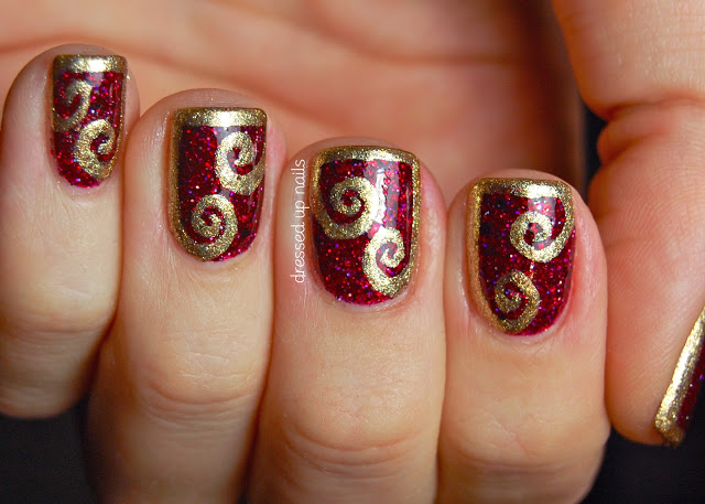 fancy-karina-half-frame-gold-swirl-nail-art-in-red-color