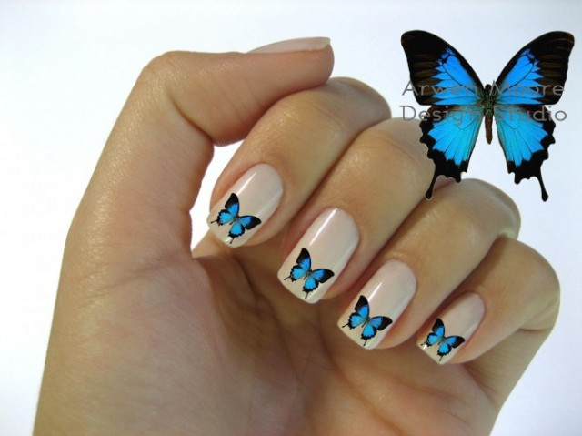 nail-art-designs-beautiful-mod-butterfly-nail-art-waterslide-inspiration-2013-loveliness-style-butterfly-nail-art-666x499