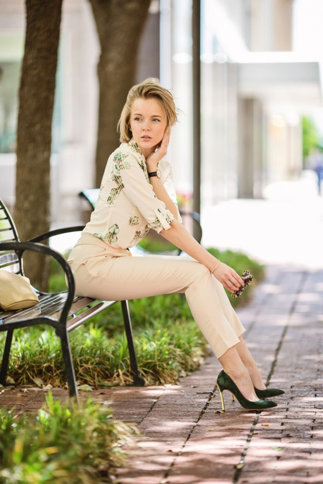 darya-kamalova-from-thecablook-in-dallas-texas-is-wearing-beige-pants-and-beige-shirt-with-green-leaves-with-marni-retro-ctutch-and-asos-handmade-sunglasses-42
