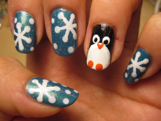 general-simple-white-snowflake-nail-art-design-on-blue-glitter-nails-idea-with-cute-penguin-nail-accent-snowflake-nail-art