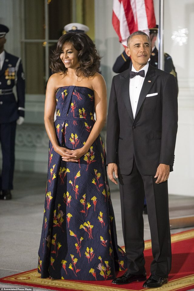 President Barack Obama and first lady Michelle Obama wait to greet Canadian Prime Minister Justin Trudeau and Sophie Grégoire Trudeau at the North Portico of the White House in Washington, Thursday, March 10, 2016, for a state dinner. (AP Photo/J. Scott Applewhite)